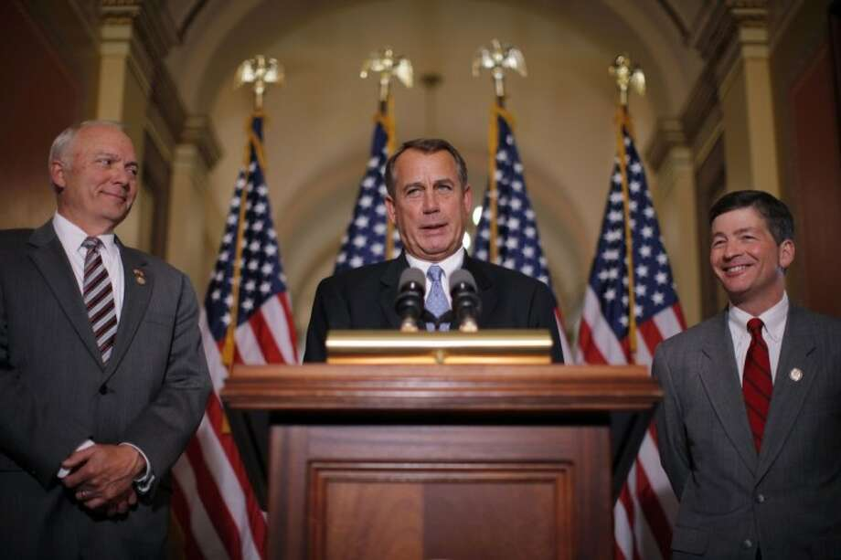 House Speaker John Boehner of Ohio, accompanied by House Education and the Workforce Committee Chairman Rep. John Kline, R-Minn., left, and Rep. Jeb Hensarling, R-Texas, speaks about a student loans bill Wednesday on Capitol Hill in Washington. Photo: Charles Dharapak