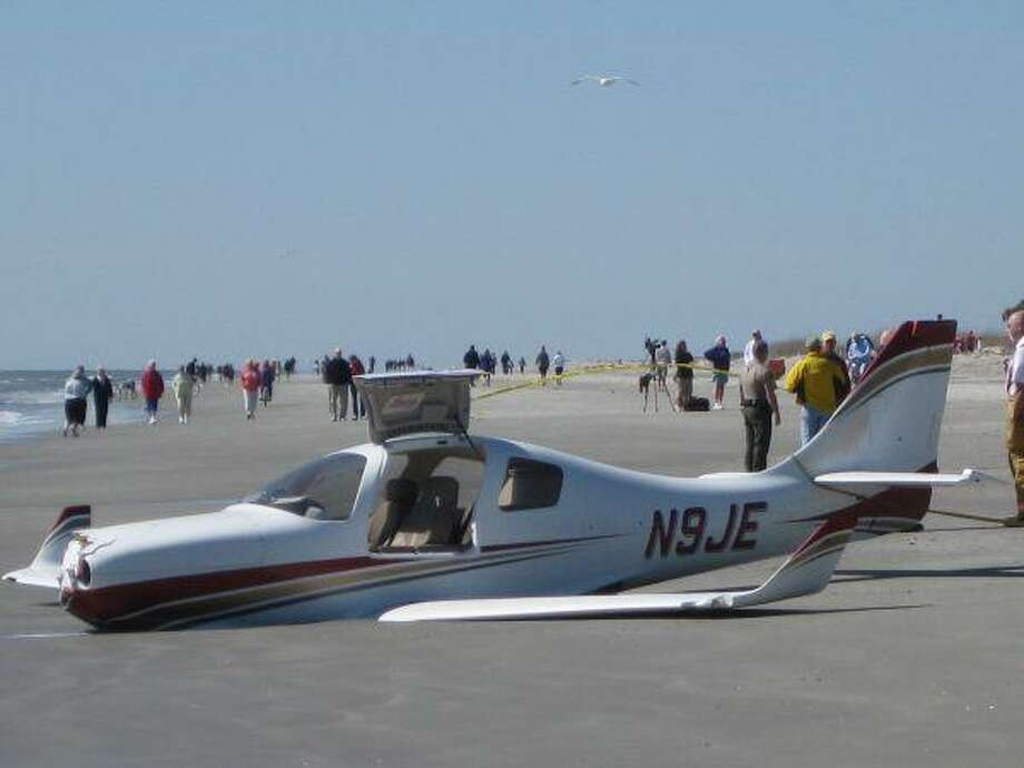 An Experimental Lancair IV-P airplane lies beached on Hilton Head Island, S.C., Tuesday, the day after its pilot made an emergency landing. The pilot, Edward Smith, and his passenger survived the crash, but a man jogging on the beach was killed when he was struck by the plane. / ap