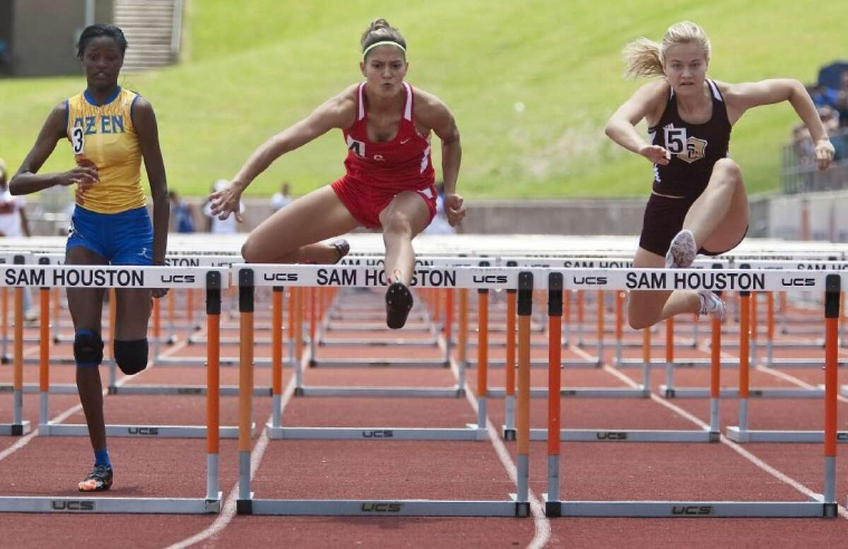 Caney Creek's Denise Corioescu competes in the 100-Meter Hurdles during the Region III-4A Track and Field Championships at Bowers Stadium in Huntsville.
