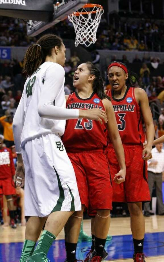Louisville's guard Shoni Schimmel, center, reacts to her shot over Baylor's Brittney Griner, left. Louisville's Sheronne Vails stands at right. Louisville upset the No. 1-ranked Lady Bears 82-81. Photo: Alonzo Adams