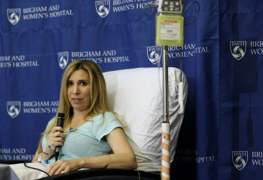 Heather Abbott, of Newport, R.I., responds to questions from reporters during a news conference at Brigham and Women's Hospital, in Boston Thursday. Abbott underwent a below the knee amputation during surgery on her left leg following injuries she sustained at the Boston Marathon bombings on April 15. Photo: Steven Senne