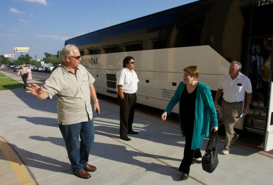 Residents from April Sound unload from a chartered bus before the start of a City of Conroe Annexation meeting Wednesday at Conroe High School. Photo: Staff Photo By Eric S. Swist