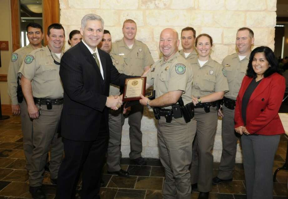 District Attorney Brett Ligon and Alicia Parmley, of Mothers Against Drunk Driving, present the 2011 DWI Agency of the Year Award to Captain Ronald Van Der Roest, of Texas Parks and Wildlife. Through enforcement on Lake Conroe by Texas Parks and Wildlife, boating while intoxicated fatalities have been nonexistent over the past three years. Texas Parks and Wildlife officers made 95 percent of the BWI arrests on Lake Conroe last year. Photo: Photo By Larry L. Melton