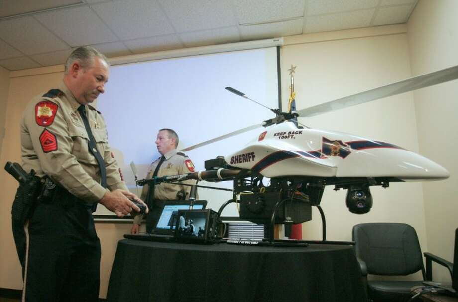 Montgomery County Sheriff's Office Sgt. Melvin Franklin controls the gyroscopic camera on the Vanguard Defense Industries Shadowhawk UAV purchased by the Montgomery County Sheriff's Office following a press conference in March. Photo: Staff Photo By Eric S. Swist