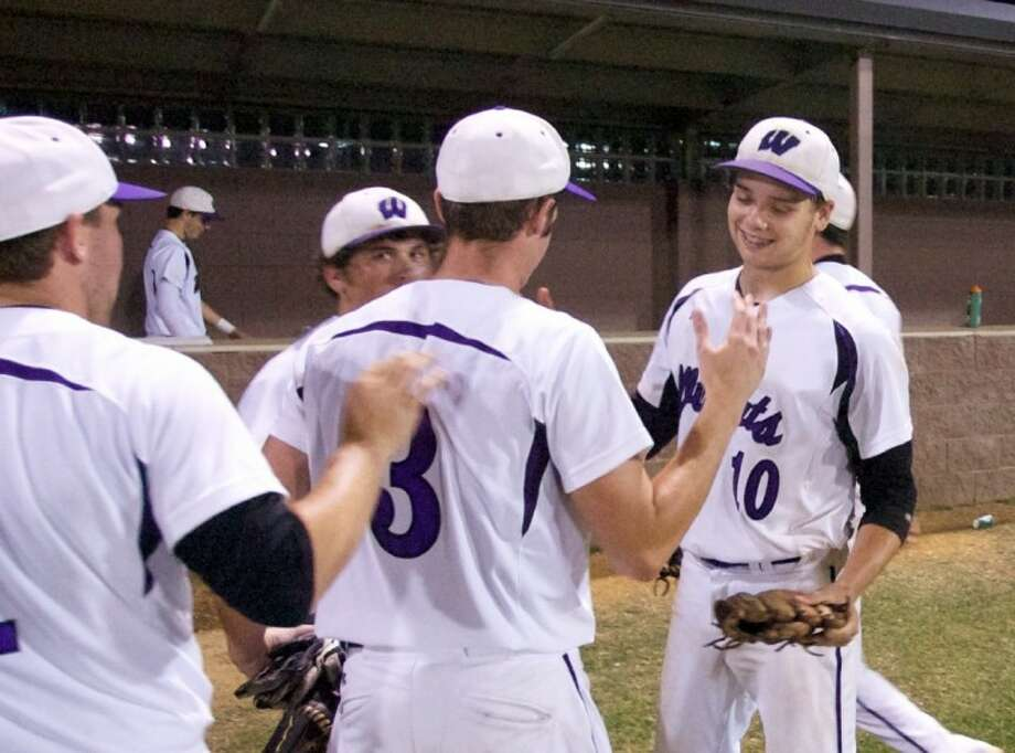 Willis players congratulate pitcher Cameron Johnson, right, after Thursday night's 6-2 playoff win against Montgomery. Photo: Staff Photo By Eric Swist