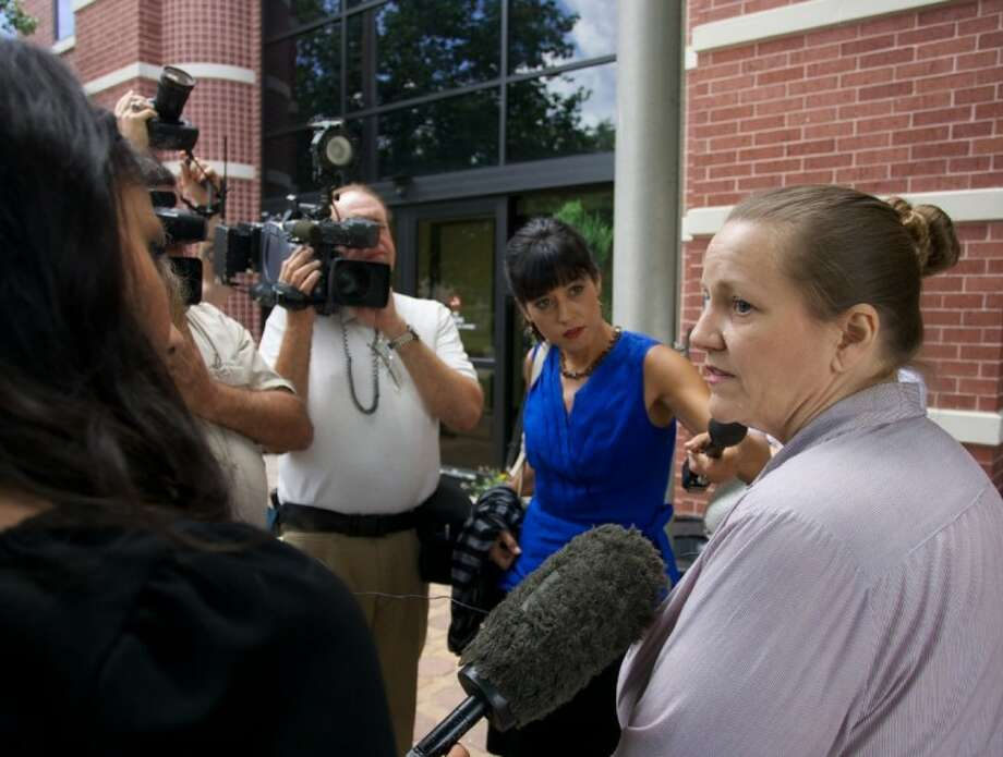 Sherrie Shorten addresses the media after a Child Protective Serivices custody hearing Wednesday in Conroe.