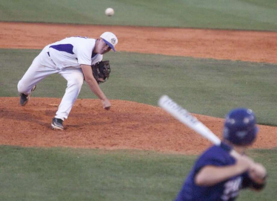 Montgomery's Chad Hayes pitches against Willis during Game 2 of the teams' best-of-three Region III-4A bi-district playoff series May 4 at Montgomery High School. The Bears won, 10-8.