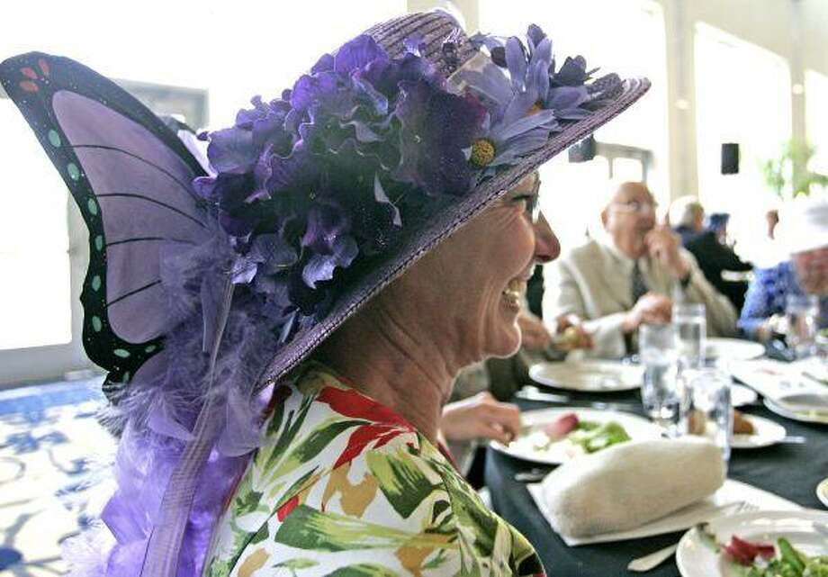 Alice Eckstrum enjoyed dinner with friends with her colorful purple hat standing out from the crowd at the Derby Day festivities at La Torretta del Lago Resort & Spa on Lake Conroe in 2009. The event, hosted by the Conroe Symphony League, celebrates the Kentucky Derby and raises money for the Conroe Symphony. This year's event is May 1. / The Courier