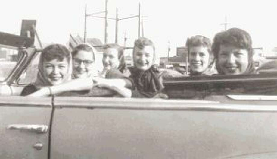 Around 1951, Gertie Spencer, first on the left, recalled her father, a Conroe auto dealership owner, getting in a beautiful red Buick convertible. She talked him in to letting her gather her friends and drive around the city.