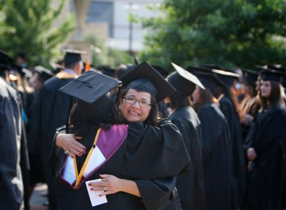 Graduate Irma Rodriguez embraces faculty member Anita Iyer, a biology professor, before the start of Lone Star College-Montgomery's commencement ceremony Friday at Fellowship of The Woodlands. Rodriguez received an Associates Degree in Liberal Arts.