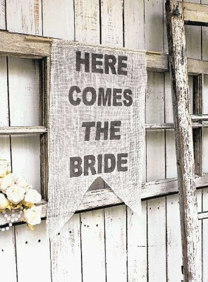 Burlap is used to advertise the bride during a rustic wedding. / @WireImgId=2621718
