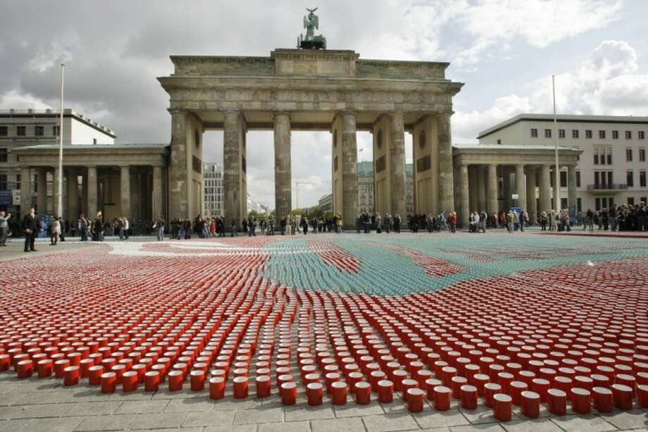 In this 2008 file photo, 77,000 cups sit in front of the Brandenburg Gate in Berlin for use in a television show to illustrate how many cups of coffee the average German drinks during their lifetime. A large U.S. federal study concludes people who drink coffee seem to live a little longer. Photo: Herbert Knosowski
