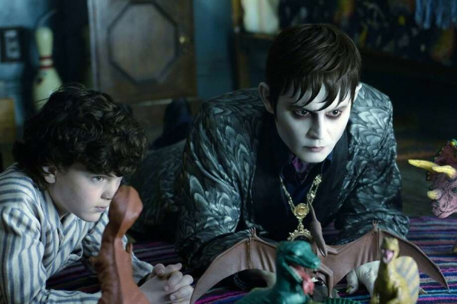 "In this film image released by Warner Bros., Gully McGrath portrays David Collins, left, and Johnny Depp portrays Barnabas Collins in a scene from ""Dark Shadows."" Photo: Peter Mountain"