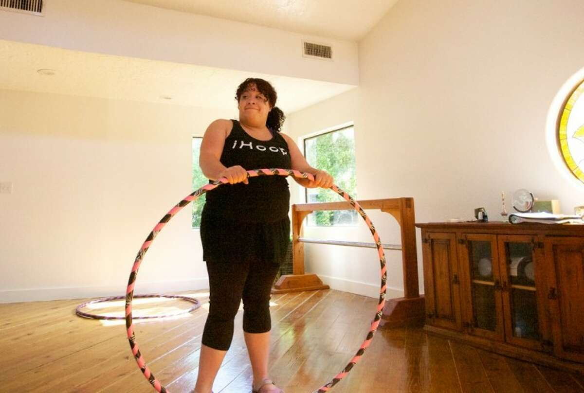 Hoopnotica instructor Heather Says smiles as she waits to start a recent class at Yoga Studio of The Woodlands.