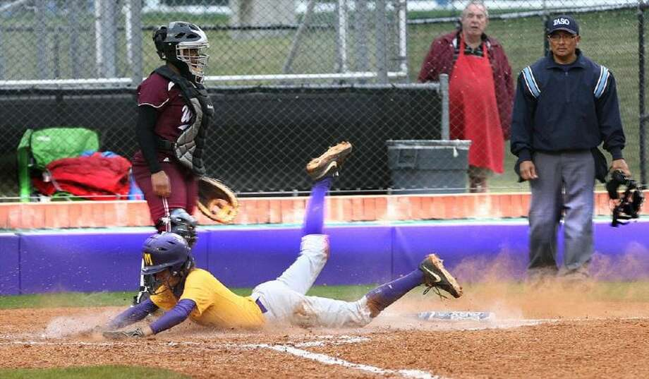 Montgomery's Bailey Watson scores on a double by teammate Devon Tunning during Wednesday evening's District 18-4A game against Waller. The Lady Bears won, 4-0.