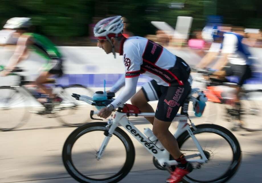 Triathletes embark on the start of the 112-mile bike ride during the Ironman Texas on May 19 in The Woodlands. More than 2,500 athletes participated in the event.