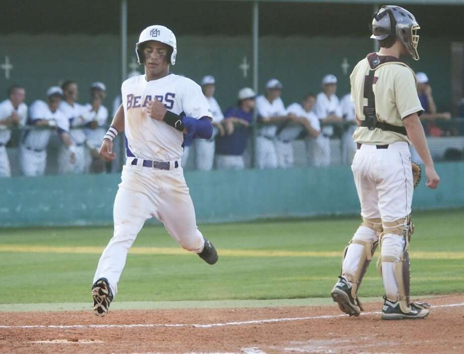 Montgomery's Jimmy Dominick scores a run during the game against Magnolia West Friday at Montgomery High School. See more photos online at yourhoustonnews.mycapture.com. Photo: Karl Anderson