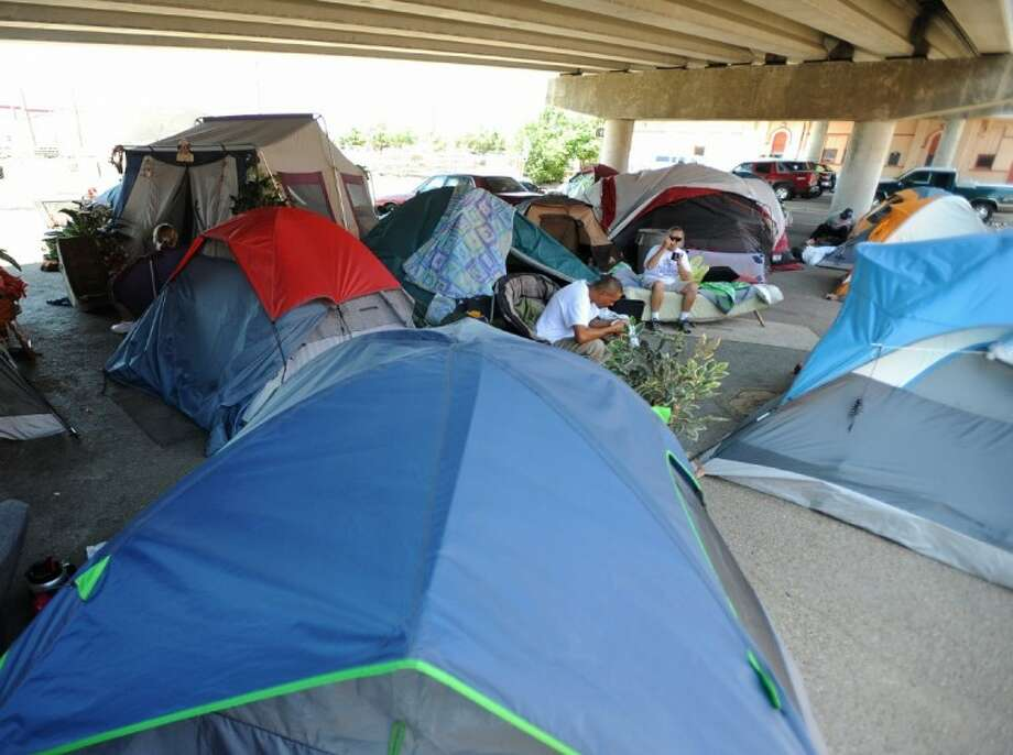 In this May 12 photo, tents are seen under the South Pierce Street overpass in Amarillo. A growing tent city in downtown Amarillo has officials considering a ban on camping in public areas. The encampment began about nine months ago with a few dozen people under an overpass and being helped by donations from Faith City Ministries. Photo: Roberto Rodriguez