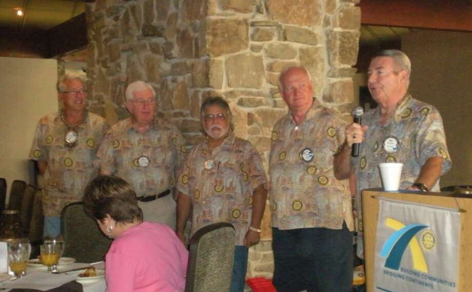 Men from The RC of Lake Conroe who attended the recent Rotary International Conference in New Orleans all dressed alike last week for their Rotary meeting. The men are wearing shirts made in Africa by women who have been rescued from abusive situations there. The fabric pictures the Rotary Cog as part of the design. The money raised from the sale of the shirts all around the world helps provide them with safe homes and helps to support their families. Pictured are: Bill Rathbun, Tony Westlake, Michael McBride, Gary Milleson and RCLC President Mike Berger.