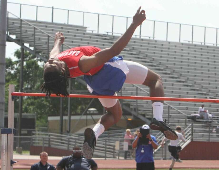 """Oak Ridge's Trumaine Jefferson competes in the boys high jump at the District 14-5A track and field meet in College Station on Tuesday. Jefferson tied for second in the event with a jump of 6'2"""". Go to HCNPics.com to view and purchase this photo, and others like it. Photo: Staff Photo By Jason Fochtman"""