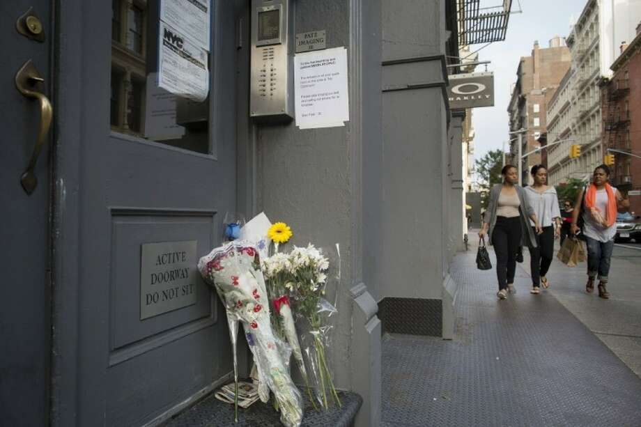 Supporters of the Patz family leave flowers on their doorstep in SoHo Friday in New York. New life has been breathed into the missing child case of Etan Patz after Pedro Hernandez implicated himself in the boy's death of the 6-year-old, whose disappearance 33 years ago on his way to school helped launch a missing children's movement that put kids' faces on milk cartons. Photo: John Minchillo