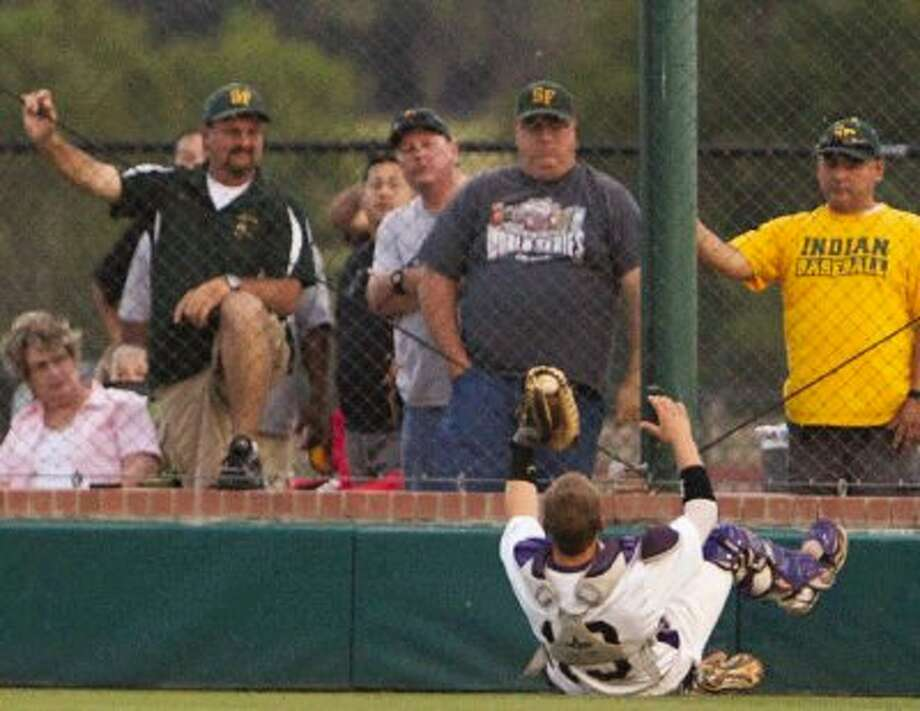 Montgomery catcher Cody Conn makes a catch during Thursday night's Region III-4A semifinal game in Montgomery. Photo: Staff Photo By Eric Swist