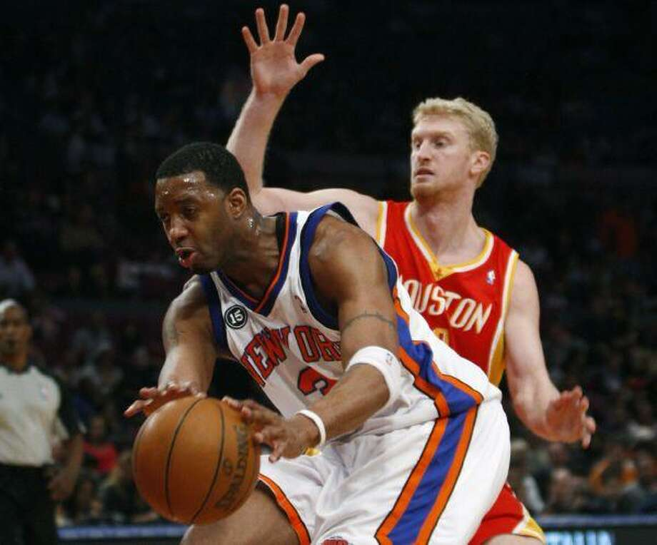 0ab391191f7 New York Knicks guard Tracy McGrady passes the ball as Houston Rockets  forward Chase Budinger defends