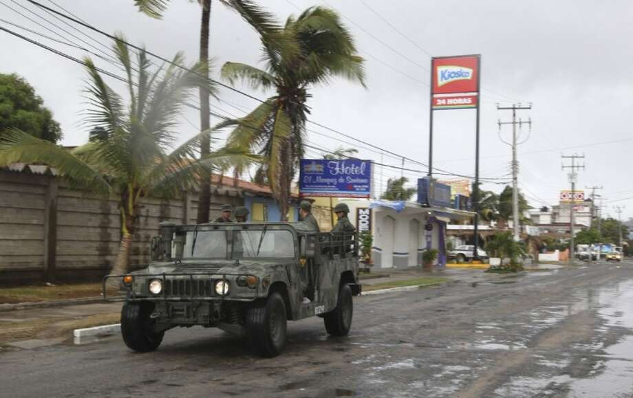 A navy vehicle drives along a street in the coastal town of Barra de Navidad as the community prepares for the arrival of Hurricane Bud along the Pacific coast of Mexico Friday. Photo: Bruno Gonzalez