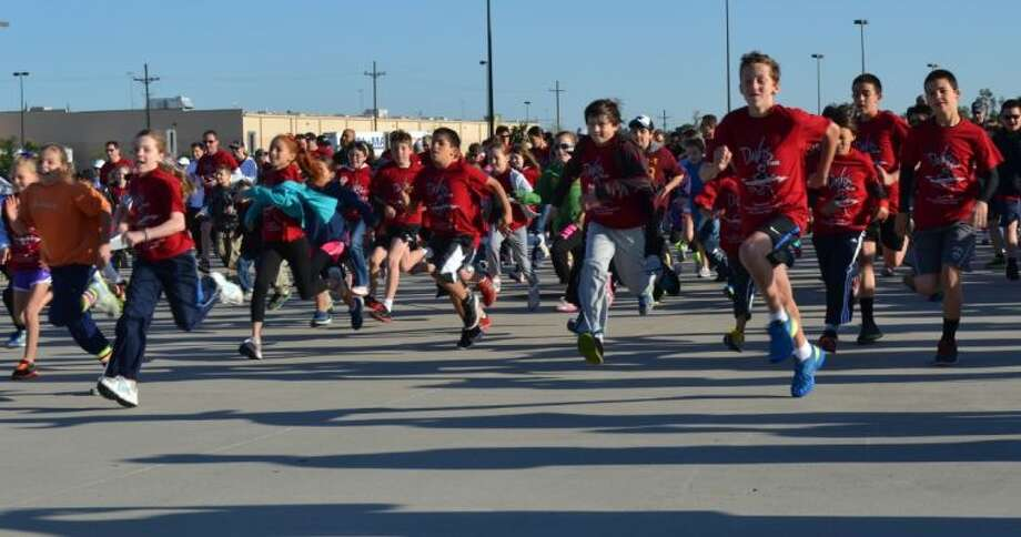 Hundreds of David Elementary students, parents and friends got up early Saturday morning for David's Dream Run to raise money for Texas Children's Hospital's David Center.