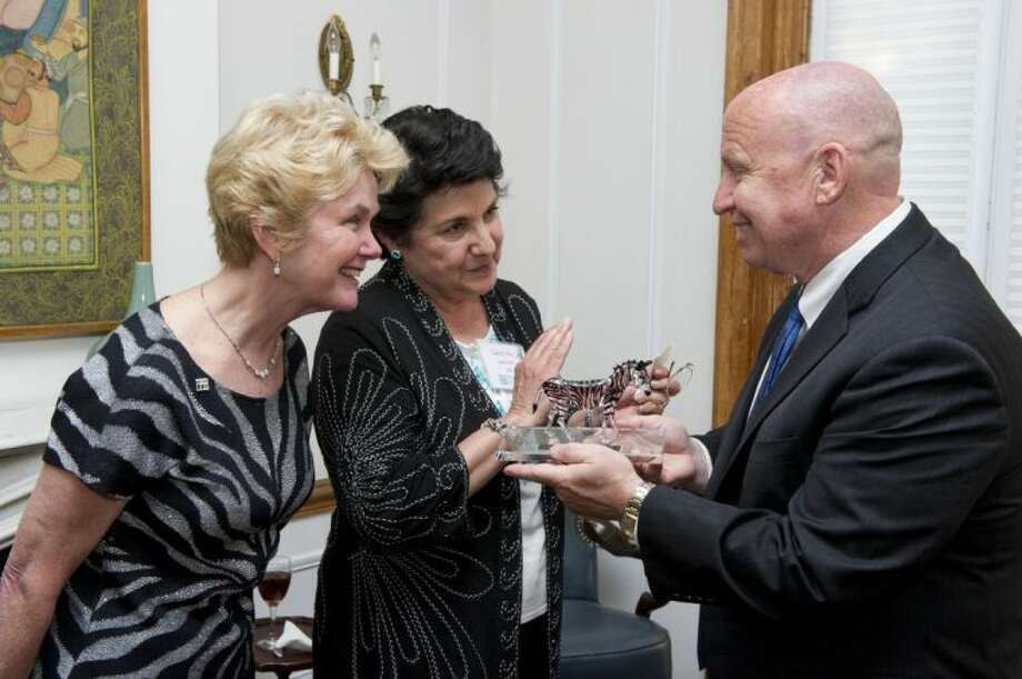 U.S. Rep. Kevin Brady, R-The Woodlands, receives an award from Carol Ann Demaret, center, mother of David Vetter, and Immune Deficiency Foundation President Marcia Boyle at an event celebrating the Medicare IVIG Access Act in Washington, D.C. Photo: RISDON PHOTOGRAPHY