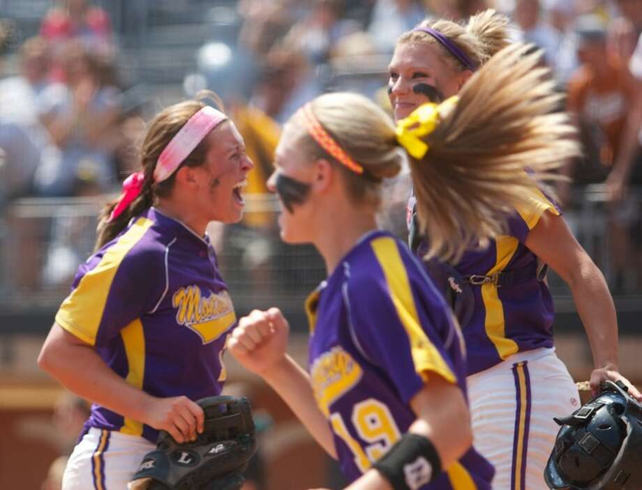 Montgomery's Morgan Skinner, left, lets out a scream after defeating Forney in Friday's state semi-final game at McCombs Field in Austin. Photo: Staff Photo By Eric Swist