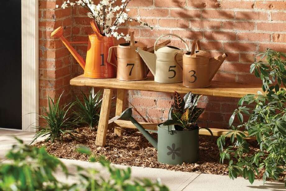 Metal products, such as tables, chairs, garden tools or even watering cans, can receive an easy and instant update with Rust Protector spray paint. Photo: Craig Brown