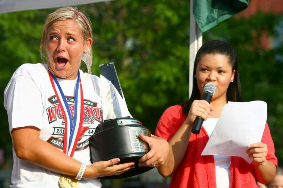 The Woodlands' Paige McDuffee reacts to receiving the Gatorade National Softball Player of the Year award during a parade on Market Street to honor The Woodlands softball team's state championship on Monday.