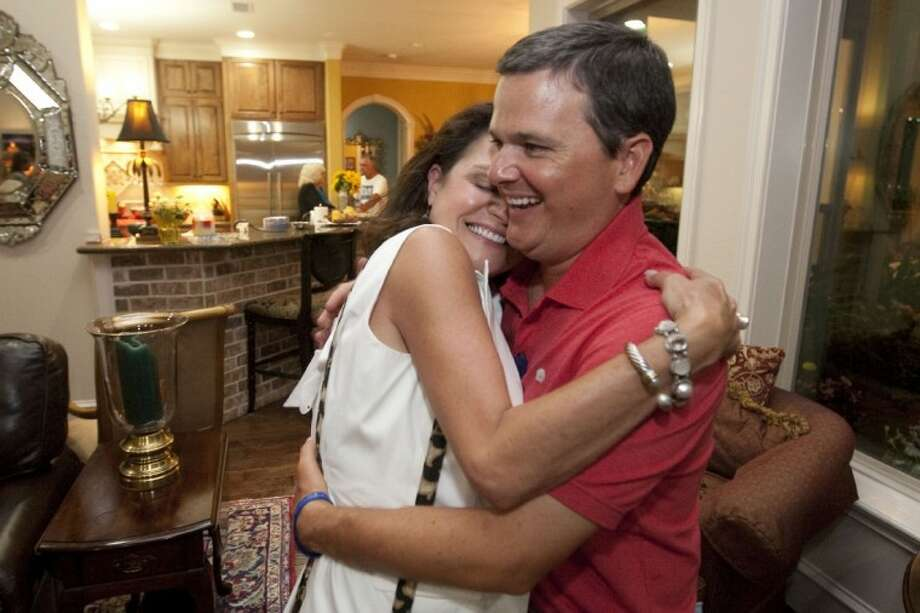 James Noack hugs Geena Cook after winning the Precinct 3 County Commissioner race during a party at the house of his fundraising chairman, JoDell Whitehead, in The Woodlands Tuesday night. Photo: Karl Anderson