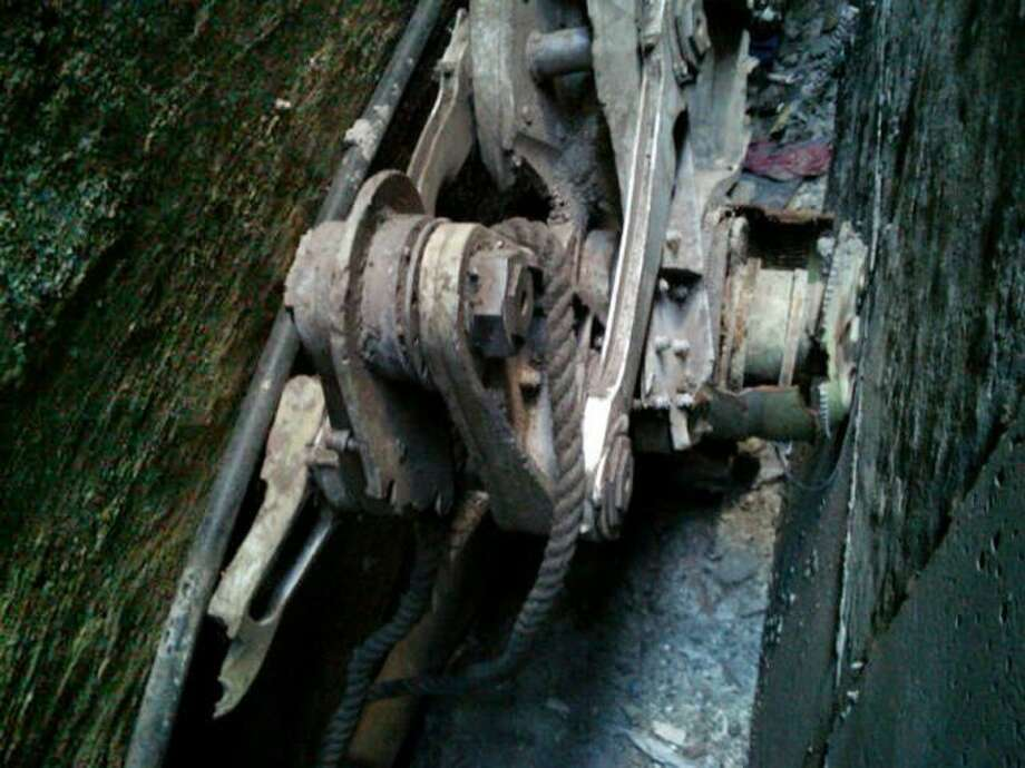 This Friday photo provided by the New York City Police Department shows a piece of landing gear that authorities believe belongs to one of the airliners that crashed into the World Trade Center on Sept. 11, 2001, that was found wedged between a mosque and another building, in New York. Photo: Uncredited