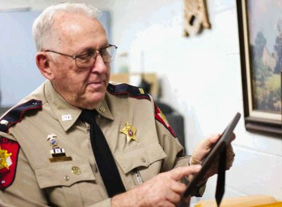 Montgomery County Sheriff's Lt. J.C. Myrick, 81, who oversees shift supervisors and handles inmate grievances at the Montgomery County Jail, reminisces about his early days in law enforcement. Photo: Staff Photo By Eric Swist