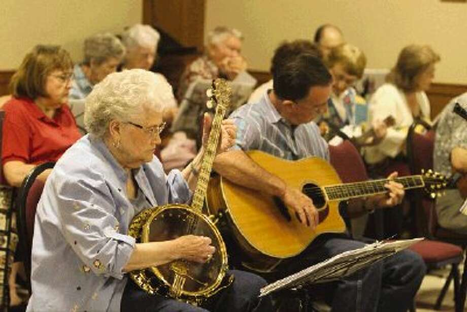 The Happy Strings Ukulele Band will perform its 15th anniversary concert on Sunday at 5 p.m. at First Baptist Church in Conroe. Photo: Staff Photo By Jason Fochtman / Conroe Courier