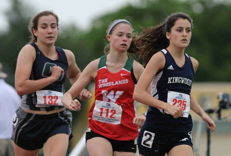 College Park's Katie Jensen, left, and Madi McLellan of The Woodlands, middle, will again see Kingwood's Sandie Raines in the 1,600-meter run at the UIL State Track and Field Championships. Photo: Staff Photo By Jason Fochtman