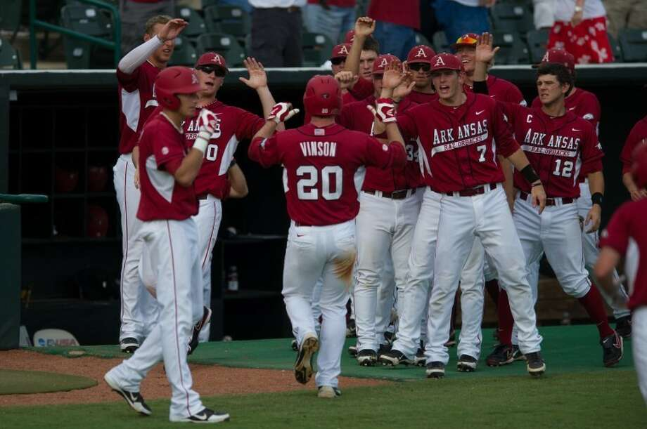 Arkansas' Matt Vinson scores off of a double by Joe Serrano in the second inning Sunday at Recking Park. The Razorbacks defeated Sam Houston State 5-1 to punch their ticket to the NCAA Super Regionals. Photo: Kevin B Long/GulfCoastShots.com
