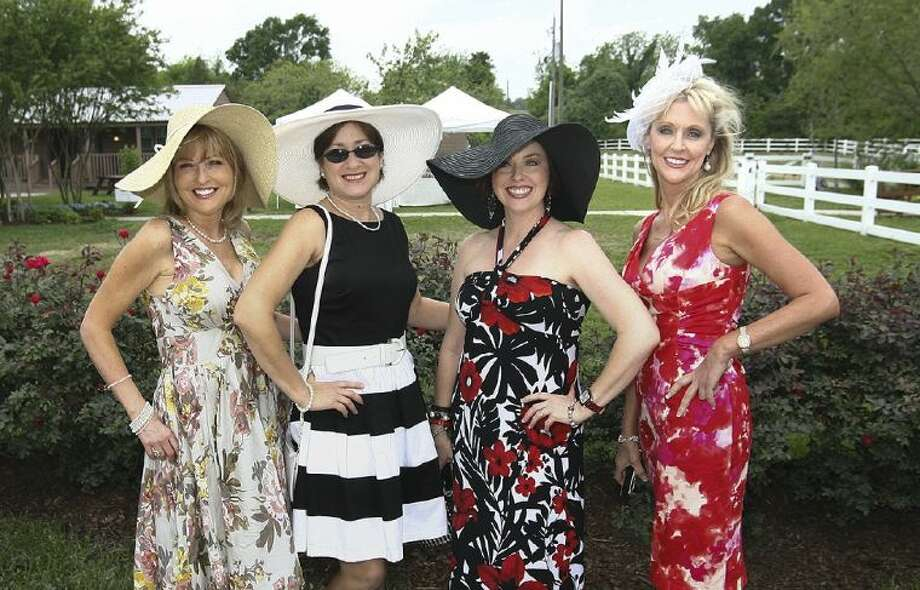 From left, Karen Lonon, Sonya Jett, Rhonda Trow and Kathy Jones at the 5th Annual Tea of the Lawn event benefiting New Danville on Friday. The community supports adults with special needs.