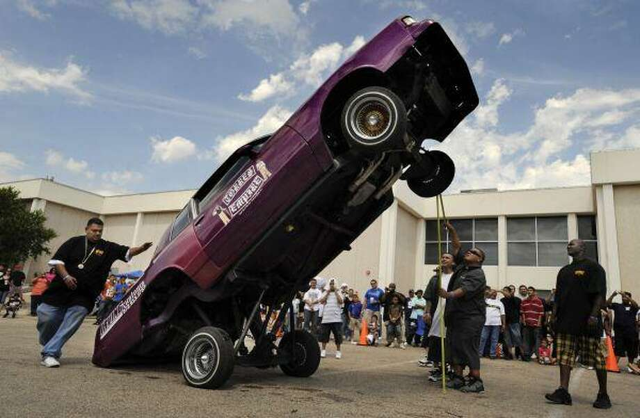 In this Sunday photo, a 1984 Chevrolet Monte Carlo rests on its rear bumper during a car bounce contest during the West Texas Custom Car Show at the Abilene Civic Center in Abilene. / AP2010