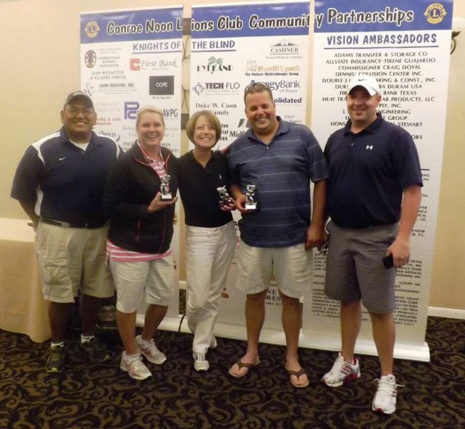 Teammates, right to left, Todd Bessegato, Adam Shahee, Terri Gaffner, and Mandy Stelzer are all smiles as they are awarded the 'Most Golf for you Money' trophies from Tournament Chairman Pete Martinez at the Conroe Noon Lions Club 27th Annual Golf Tournament last week.