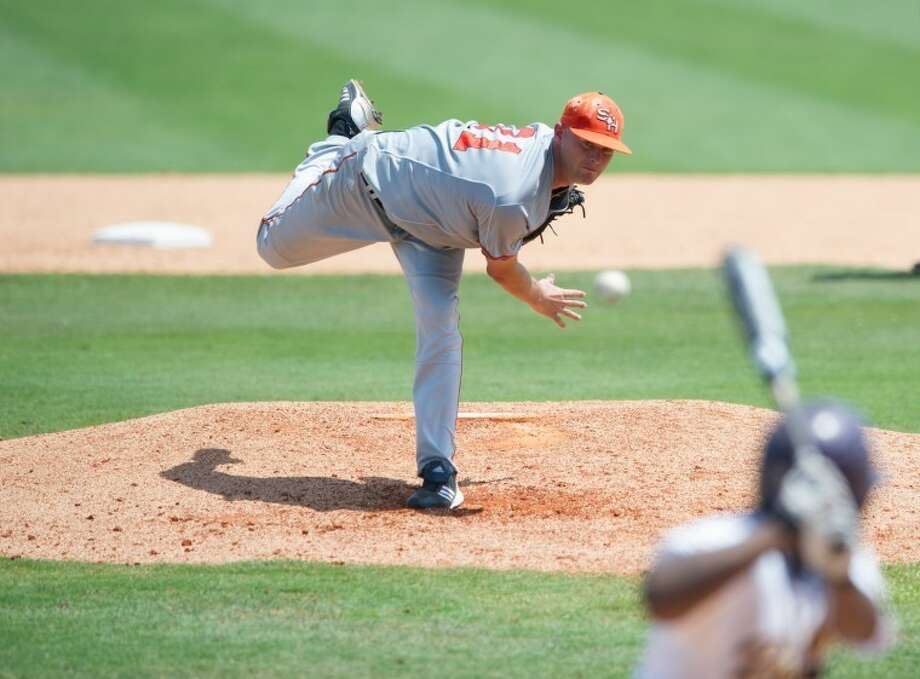 Sam Houston State senior Justin Jackson (Magnolia) held Prairie View A&M to two unearned runs in eight innings Saturday. The Bearkats won 4-2 to remain in the NCAA Houston Regional. Photo: Kevin B Long/GulfCoastShots.com