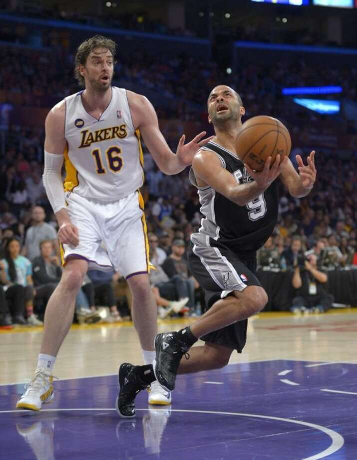 Spurs guard Tony Parker looks for a shot against the Lakers' Pau Gasol. The Spurs won 103-82 to sweep the series. Photo: Mark J. Terrill