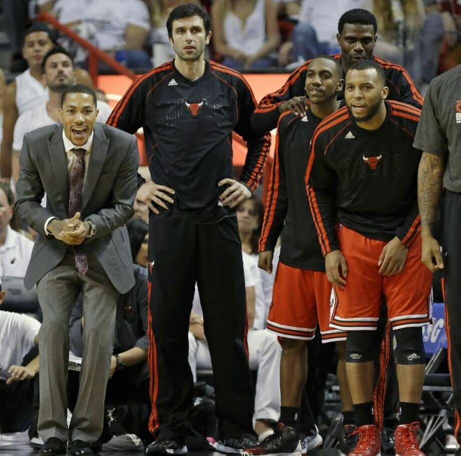 The Chicago Bulls bench, from left, Derrick Rose, Vladimir Radmanovic, Marquis Teague, Nazr Mohammed and Daequan Cook react during the second half of Game 1 against the Miami Heat on Monday in Miami. Photo: Lynne Sladky