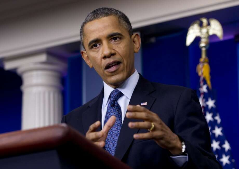 President Barack Obama talks about the economy Friday in the briefing room of the White House in Washington. Photo: Carolyn Kaster