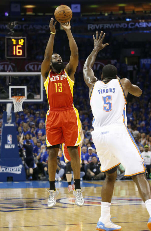 Houston Rockets guard James Harden shoots over Oklahoma City Thunder center Kendrick Perkins in the first quarter of Game 5 on Wednesday in Oklahoma City. Photo: Sue Ogrocki