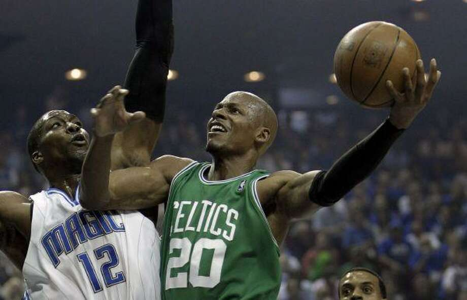 Boston Celtics guard Ray Allen shoots over Orlando Magic center Dwight Howard during the first half in Game 1 of the NBA Eastern Conference basketball finals in Orlando, Fla., Sunday. / AP2010
