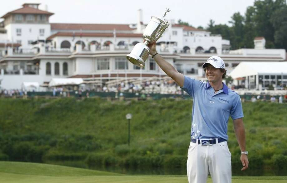Rory McIlroy poses with the trophy after winning the U.S. Open Championship in Bethesda, Md., Sunday. Photo: Evan Vucci
