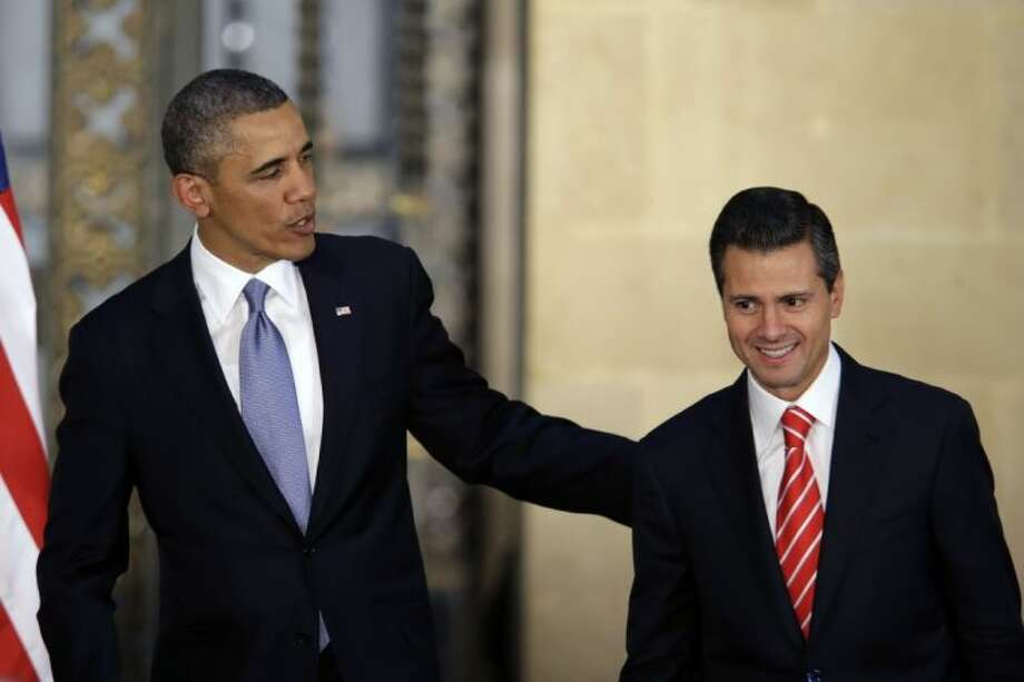 President Barack Obama and Mexico's President Enrique Pena Nieto leave after offering a joint news conference in Mexico City, Mexico, Thursday. Seeking to put a new spin on a long-standing partnership, Obama is promoting jobs and trade — not drug wars or border security — as the driving force behind the U.S.-Mexico relationship. Photo: Dario Lopez-Mills